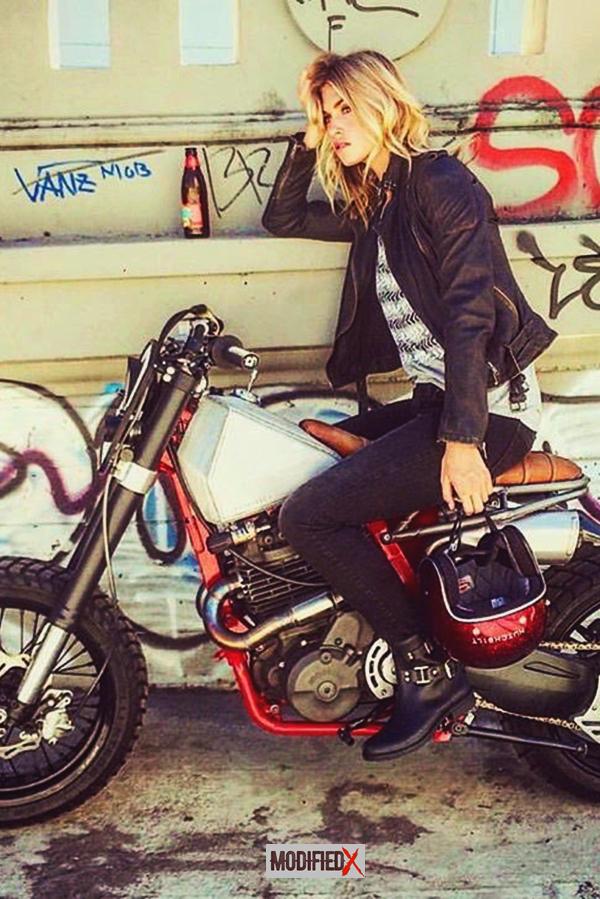 Beautiful blonde rides naked motorcycle