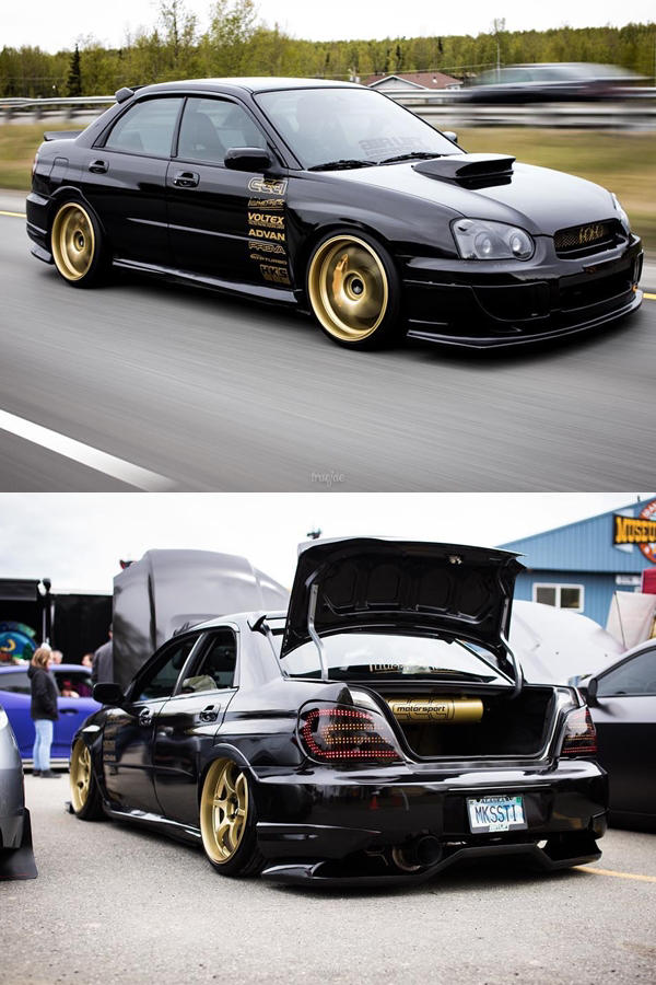 Custom black 2005 Subaru STi with gold rims