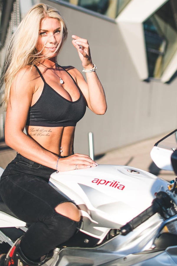 Hot blonde girl loves superbike