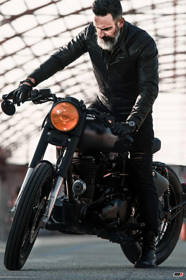 Custom Royal Enfield Class 350 matte black rider