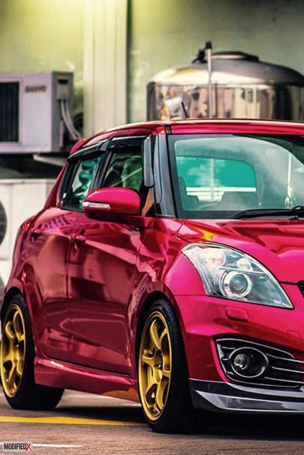 Modified Maruti Suzuki Swift custom with gold alloy wheels