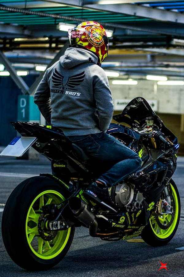 Black BMW S1000RR rider with AGV Pista GP R
