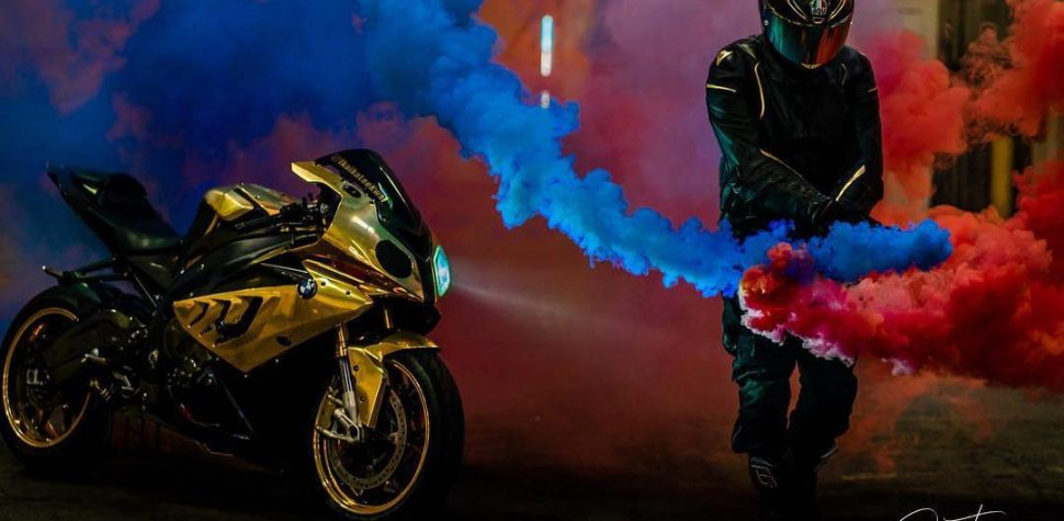 Gold BMW S1000RR and rider