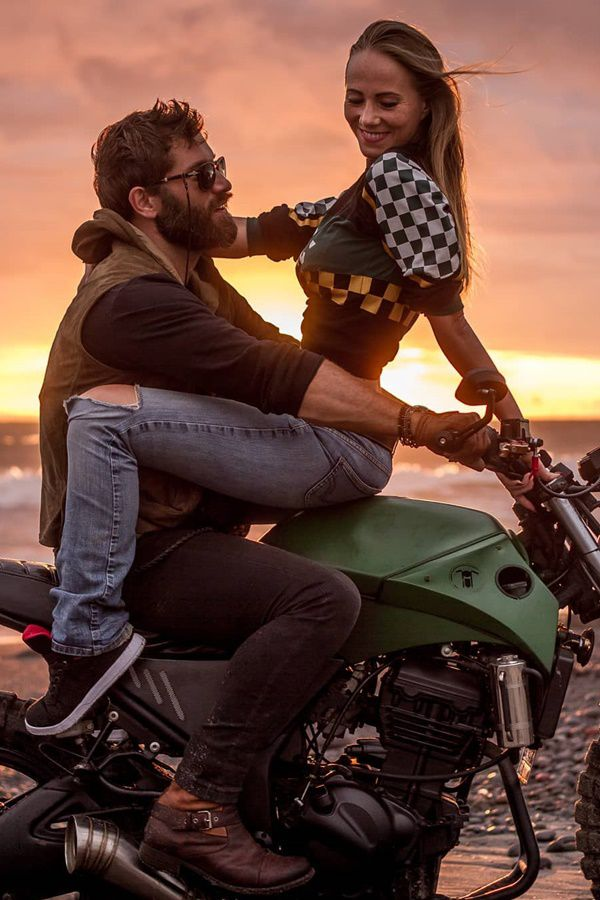 Guy and girlfriend on motorcycle