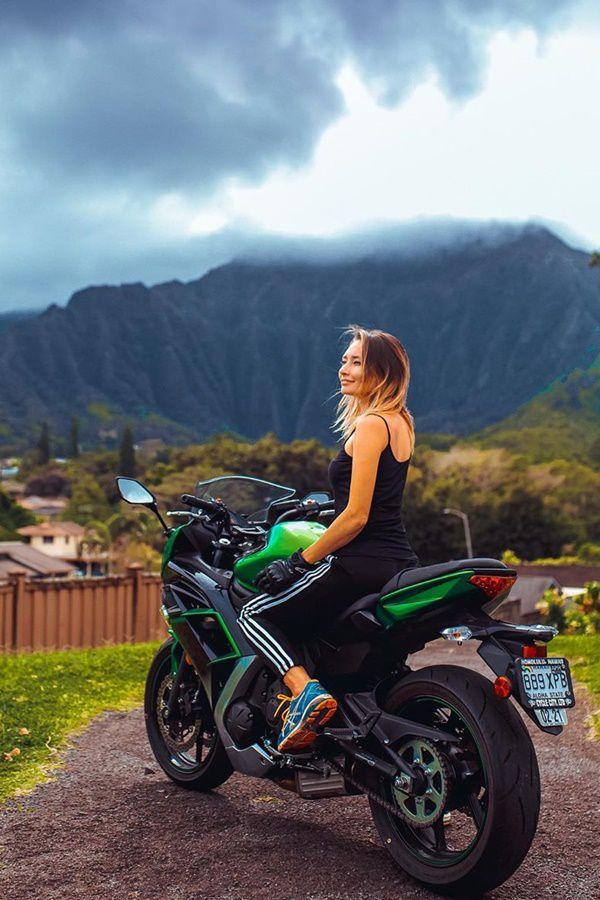 hot girl in black top in Kawasaki Ninja in front of mountain