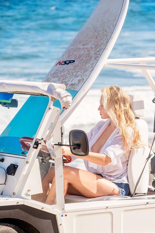Women driving in beach in beach dress