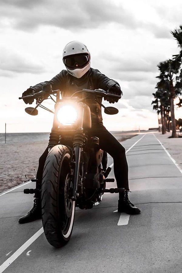 Dude rides Harley Sportster on beach walk