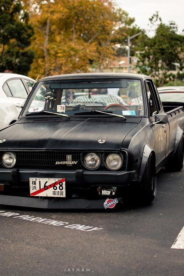 black coloured slammed datsun truck