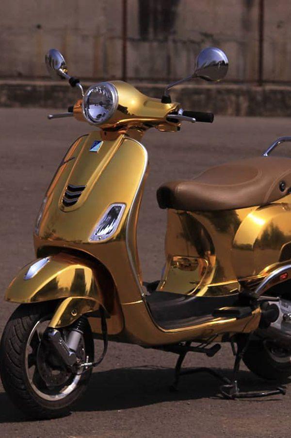 Sides of Vespa scooter golden