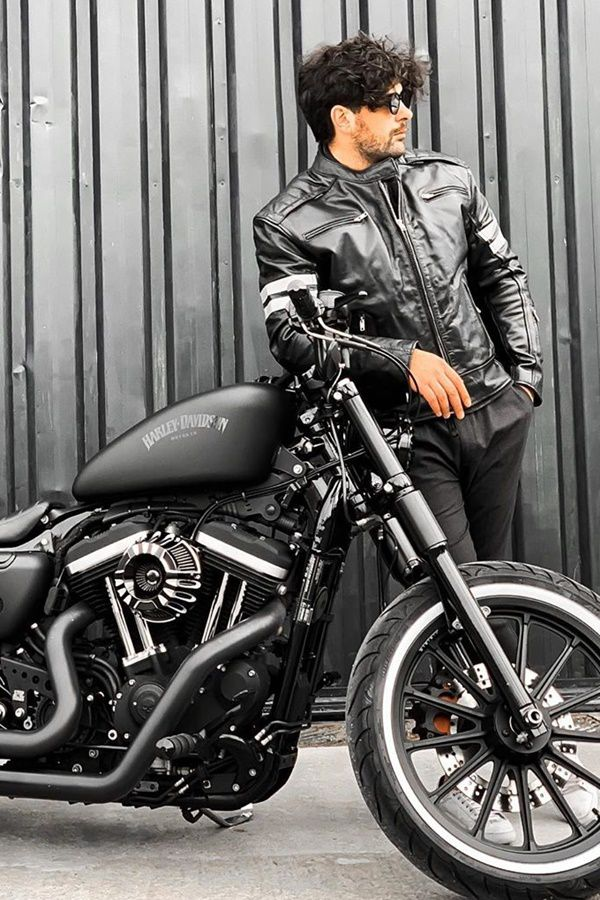 Hot guy with messy hair near HD Sportster bike