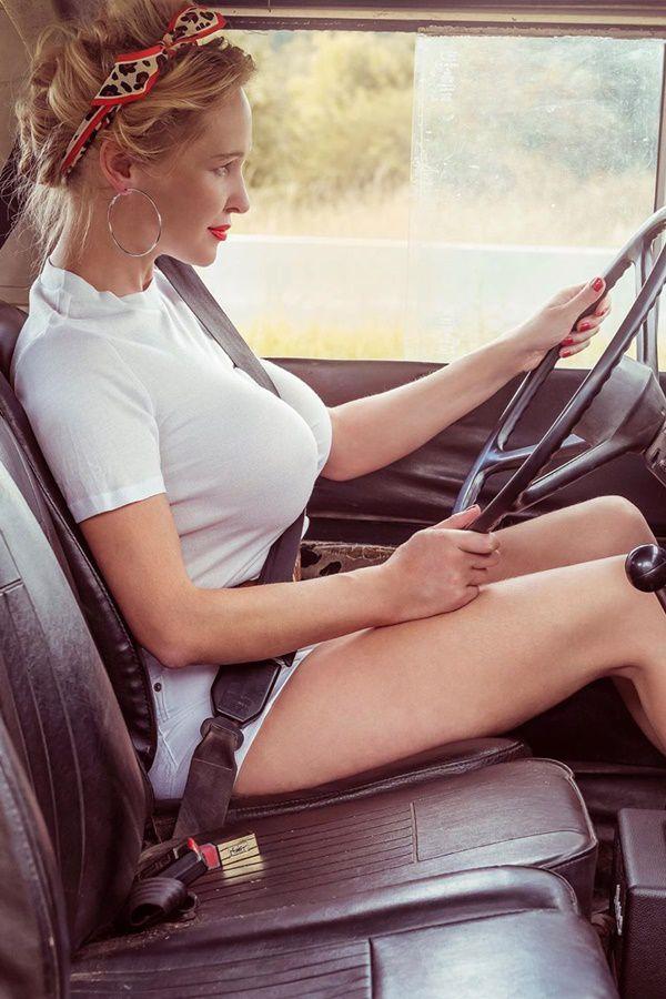 women driving a land rover