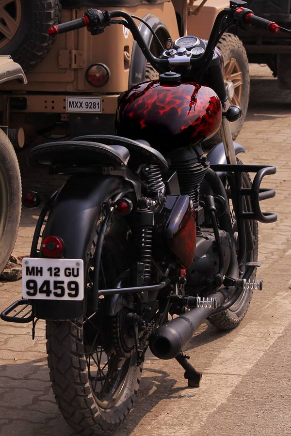 Black royal enfield modified with flame red tank