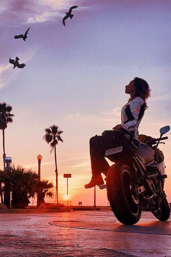 Hot Yamaha rider girl looking at birds in beach
