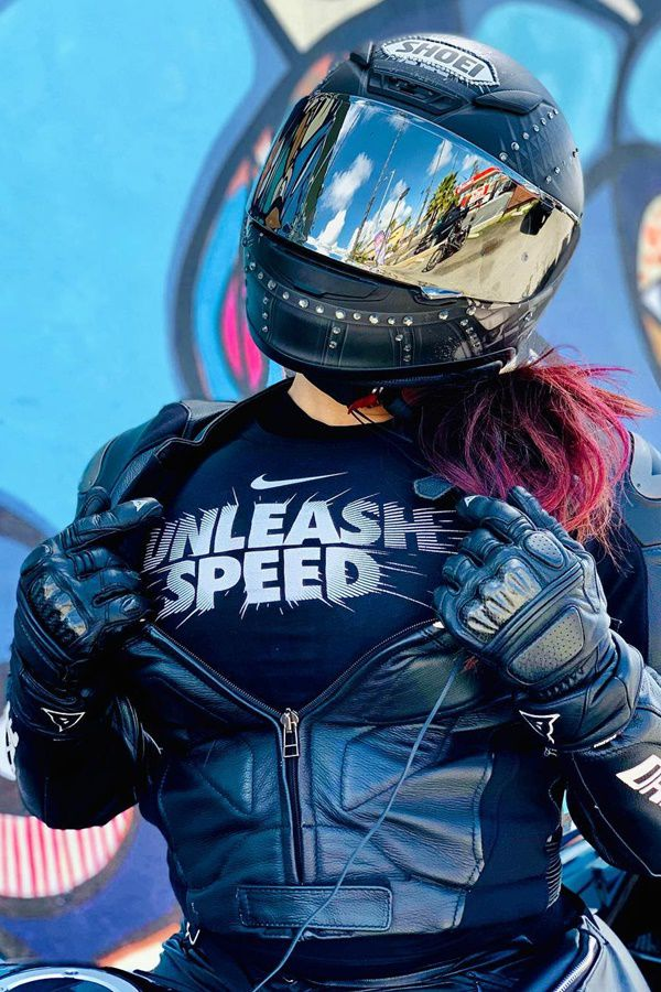 unleash speed tshirt wearing women with nike logo