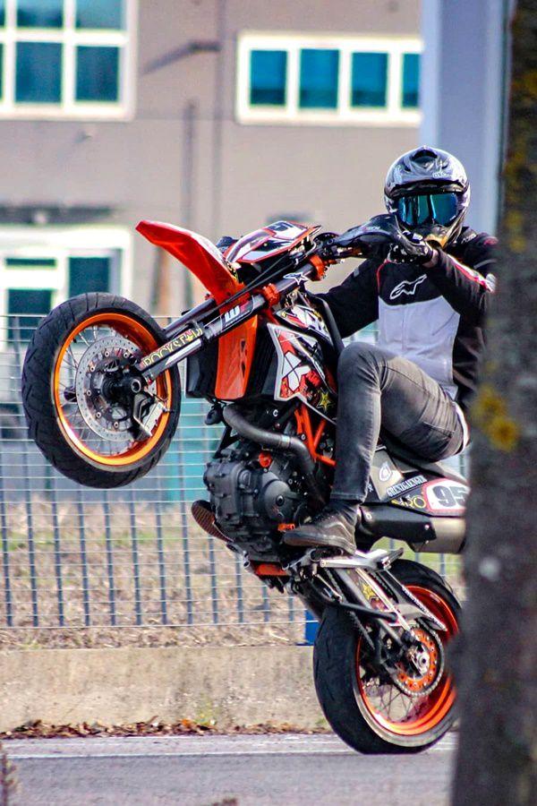 motocross wheelie on road