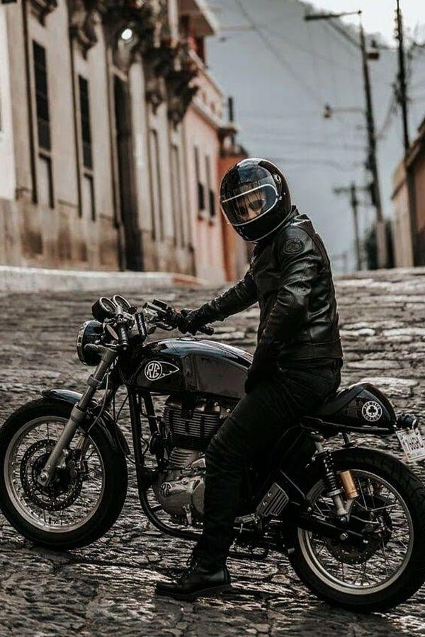 black royal enfield cafe racer rider