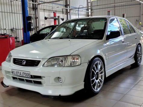 Honda City in custom garage
