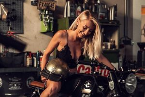 Girl laughing on Motorcycle garage