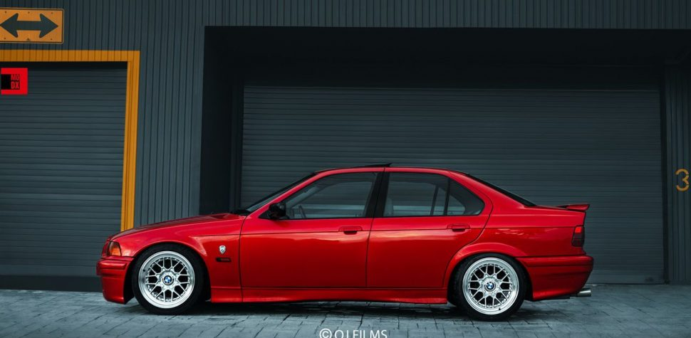 BMW E36 red with silver wheels