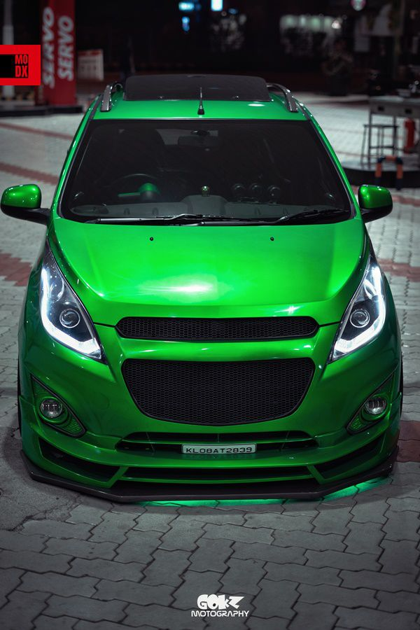 lowered green chevy hatchback