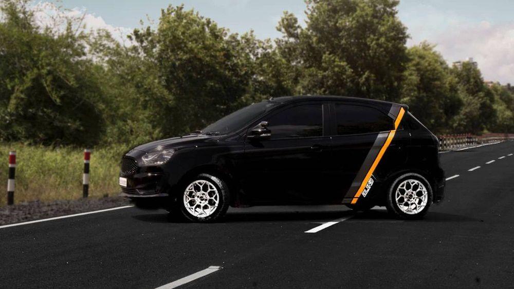 Black hatchback on road